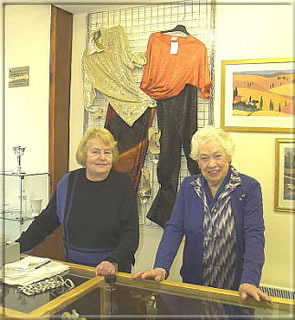 Volunteers Ann Farimond and Hazel Cowley pause for the photographer in between serving a large crowd of customers